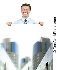 Business man holding a white board with corporate buildings...