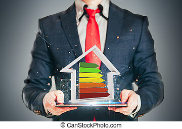 Business man holding an efficiency performance scale,...