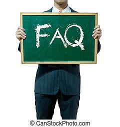 Business man holding blackboard on the background , FAQ