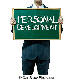 Business man holding blackboard on the background , Personal development
