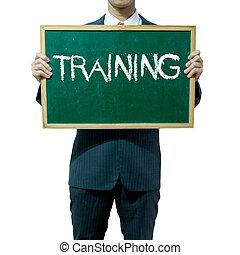 Business man holding blackboard on the background , Training