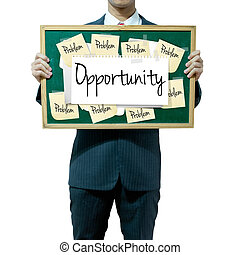 Business man holding board on the background, Opportunity