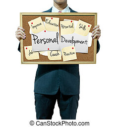Business man holding board on the background, Personal Development concept