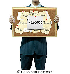 Business man holding board on the background, Success concept
