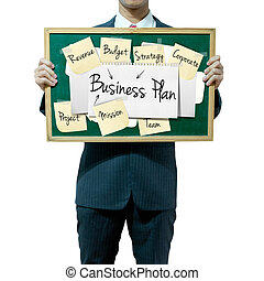 Business man holding board on the background, Business Plan...