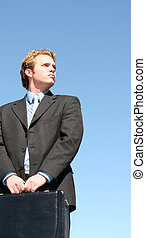 Business man holding briefcase - Blond haired business man...