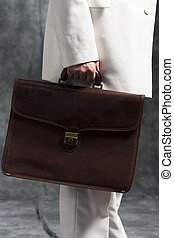 Business man holding briefcase