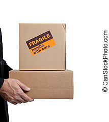 Business man holding brown corrugated, cardboard moving box on white