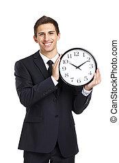 Business man holding clock