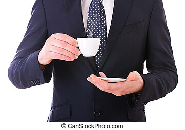Business man holding cup of coffee.