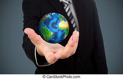 Business man holding earth in his hand (Elements of this image furnished by NASA)