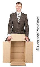 Business man holding empty box
