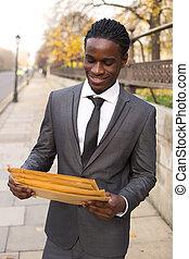 business man holding envelopes.