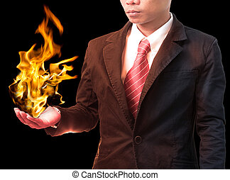business man holding fire flaming on hand use for hot topic