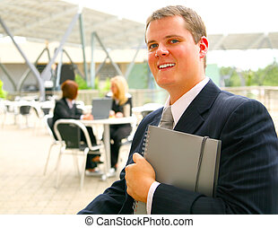 Business Man Holding Notebook