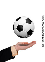 Business man holding soccer ball in his hand