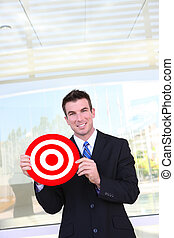 Business Man Holding Target