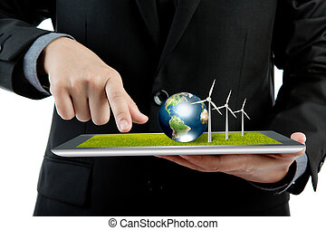 Business man holding the modern digital tablet pc with wind turbine and earth (Elements of this image furnished by NASA)