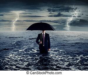 Business Man Holding Umbrella On The Sea