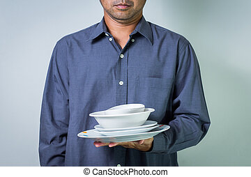 business man holding white plates