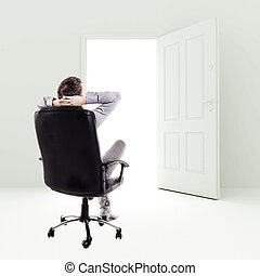 business man in a chair in front of open door