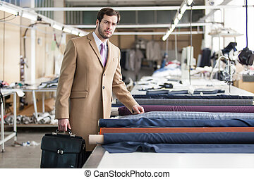 business man in a factory