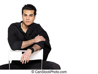 man in black shirt sitting on chair on isolated
