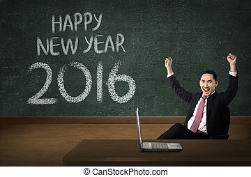 Business man in front of happy new year 2016 writing