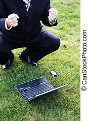 Business Man in Grass with Laptop