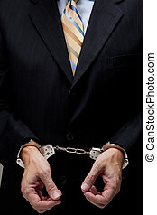 Business man in handcuffs - White collar criminal in a...