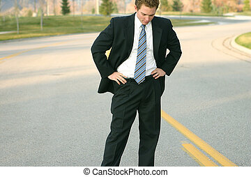 Business man in middle of road - Business man is wearing a ...