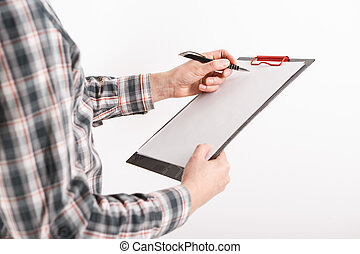 Business man in suit holding a blank clipboard