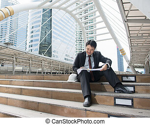Business man is working outdoor