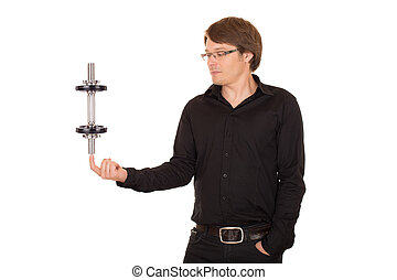 Business man juggling with dumbbell
