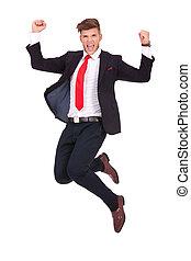business man jumping ecstatic - young business man jumping...