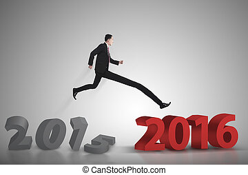 Business man jumping from 2015 to 2016