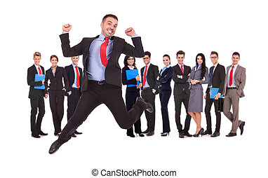 business man jumping in front of his business team