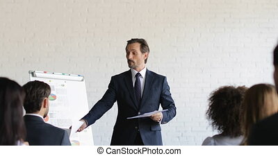 Business Man Leading Training Seminar Give Group Of...