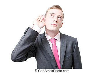 Business man listening - A business man listening isolated ...