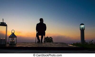 business man look sunrise on terrace