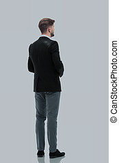 Business man looking at something  isolated on white background