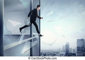 Business man looking stress, jump through window