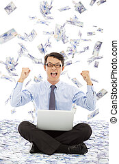 business man make a victory gesture with money rain
