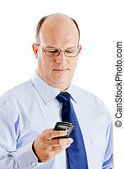 Business man - Middle-aged businessman sending a text...