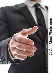 Business man offering a handshake