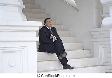 Business man on a stair