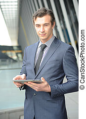 Business man on his ipad.