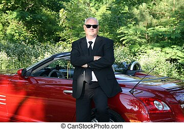 business man on sports car - a business man dressed in a...