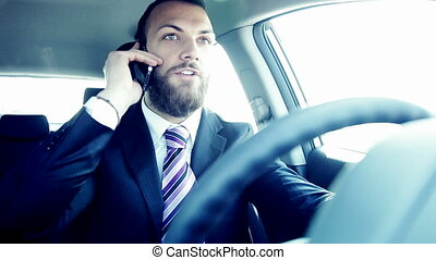 business man on the phone driving