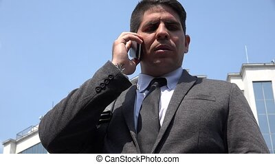 Business Man Or Politician Talking On Cell